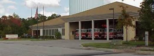 Picture of Station 223 from across the street with the bay doors opened viewing the apparatus