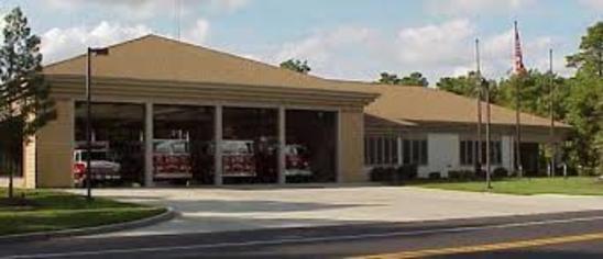 Picture of Station 225 from across the street with bay doors opened viewing apparatus